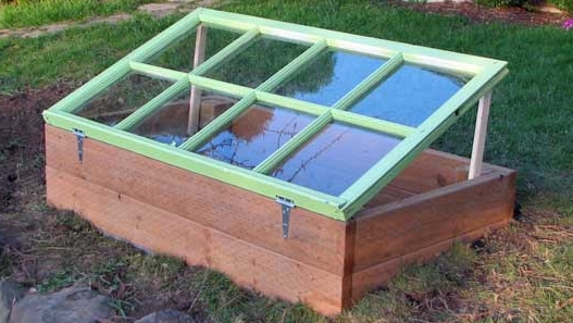 a useful cold frame made of recycled timber and an old window casement