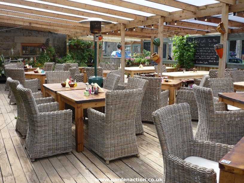 Covered outdoor seating area for Garden designs seating areas